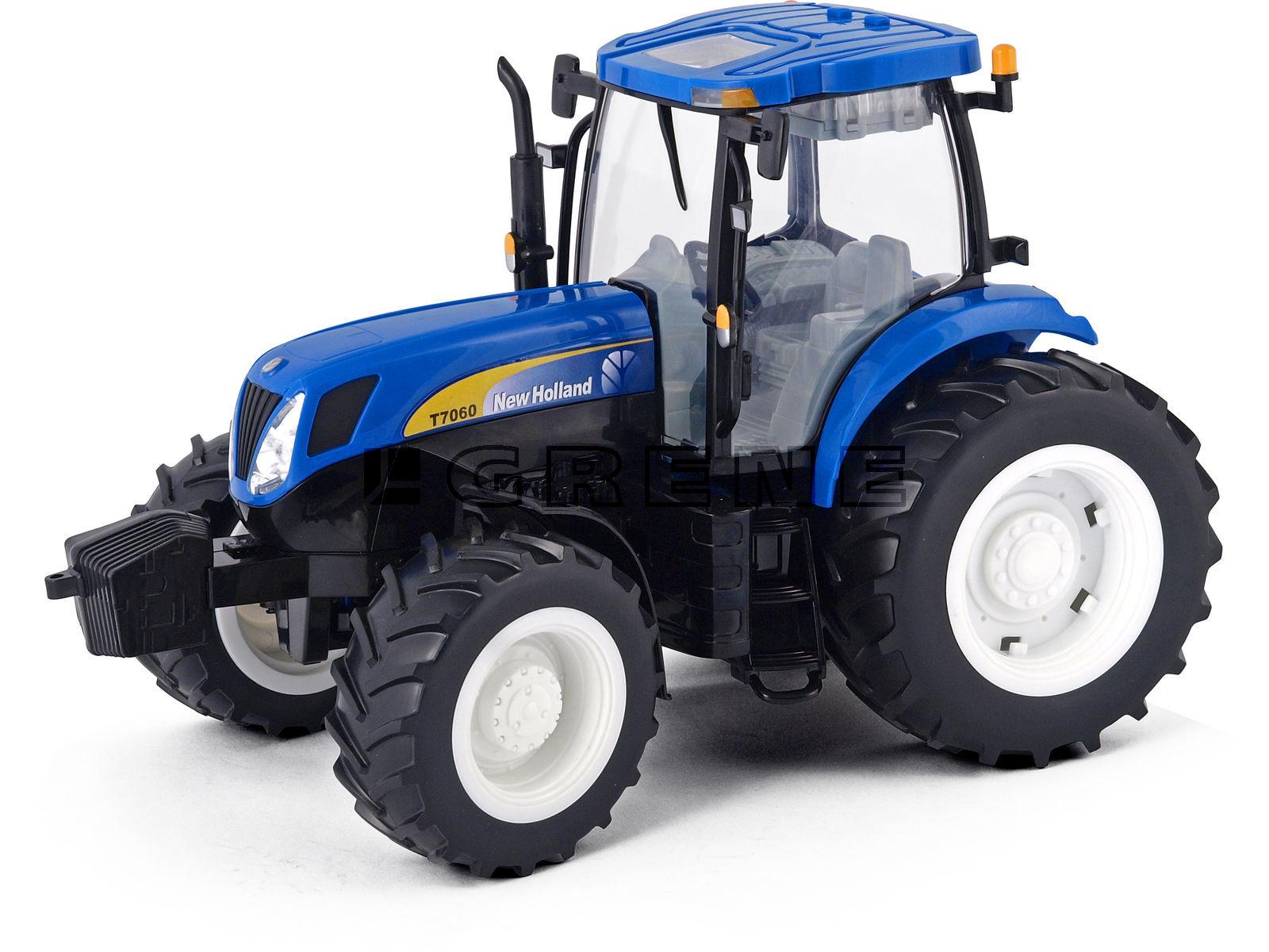 Машинки и мотоциклы Tomy New Holland T7 машины tomy трактор john deere monster treads с большими резиновыми колесами